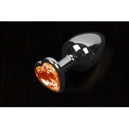 Пікантні Штучки Велика срібляста анальна пробка з кристалом у вигляді серця 8,5Х4 см, помаранчева